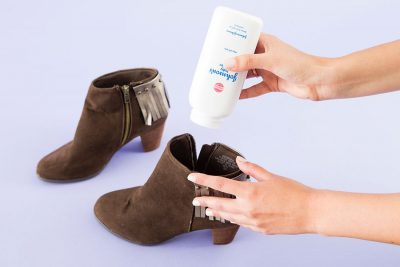 SHE SPRINKLED BABY POWDER IN HER SHOES TO GET RID OF BAD SMELLS! IT WORKS WONDERFULLY!