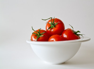 Do not store tomatoes in the fridge. This will make them go bad faster.