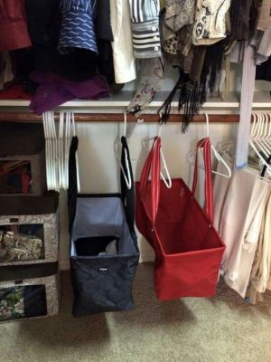 Hang totes on hangers in your closet to create more storage space for your clothes and other items.