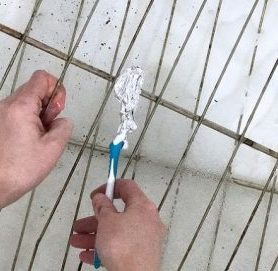 Wrap a toothbrush wit aluminium foil and use to scrub your oven racks.