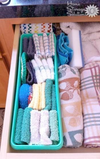 Organize your dishtowels by folding them in placing them in a plastic bin your kitchen drawer. This saves space and ensures everything stays neat and organized.