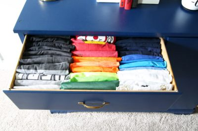 Fold t-shirts and pants vertically and store in bedroom drawers to save space.