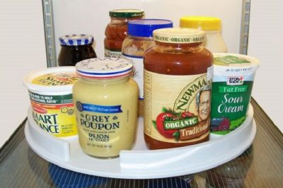 What a smart way to store condiments so that they are easy to reach and it saves space!