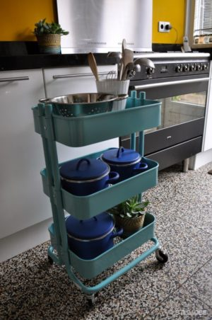 Use a rolling cart to store and organize extra pots and pans and other kitchen essentials. It can be rolled away into a closet when not in use.