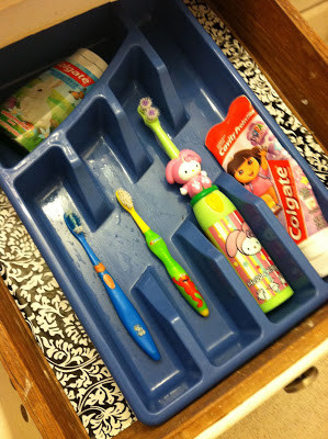 Store and organize your kids' toothbrushes using a utensil tray.