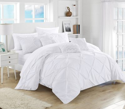 Use white linens on bed to make your home feel more luxurious.
