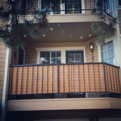Use bamboo blinds to  cover your balcony for a privacy from neighbors.