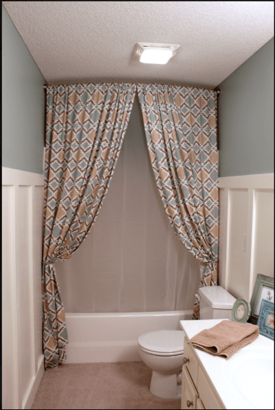 Hang shower curtains near the ceiling to create the illusion of a larger bathroom.