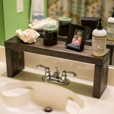 When short on counter space, you can add a shelf to store bathroom essentials.