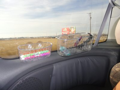 When traveling with kids, use a suction sink caddy to store markers and crayons.