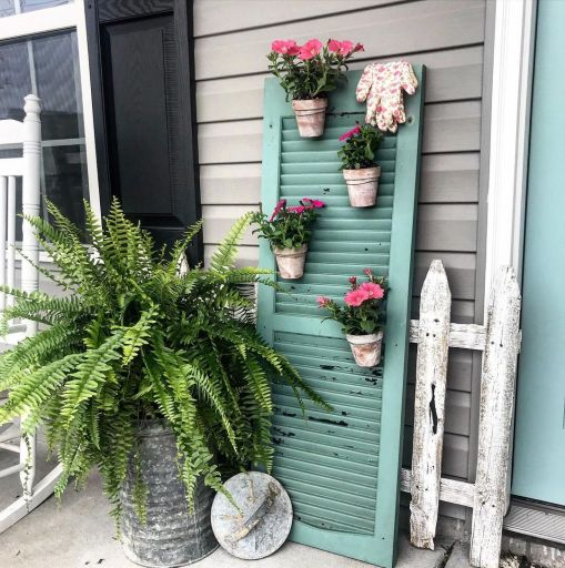 Rustic window shutter decor for front porch