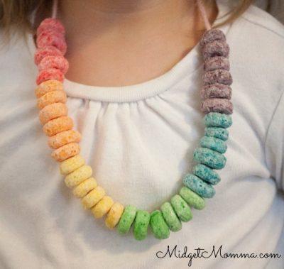 Keep the munchies at bay and little hands entertained while you're running errands by creating a cereal necklace. | Toddler Parenting Hacks