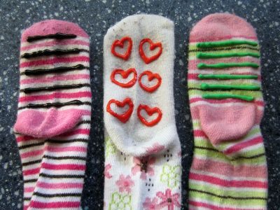 Use puff paint on the bottom of slippers to prevent falls. | Toddler Parenting Hacks