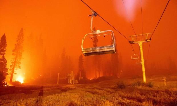 Flames surround ski lift at Sierra-at-Tahoe Resort, a ski area, during the Caldor fire in Twin Bridges, Calif. Photo: JOSH EDELSON / AFP