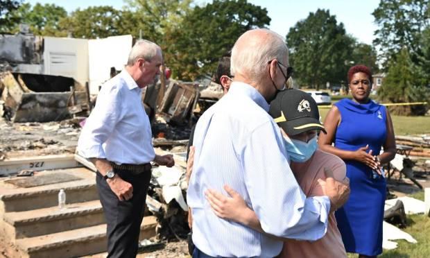 US President Joe Biden hugs a person as he travels through a neighborhood affected by Hurricane Ida in Manville, NJ Photo: MANDEL NGAN / AFP