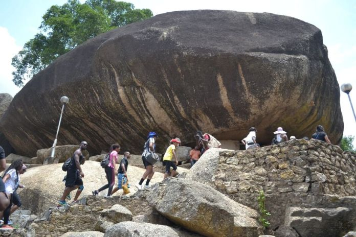 Tourist going up Olumo rock, Abeokuta, Ogun State