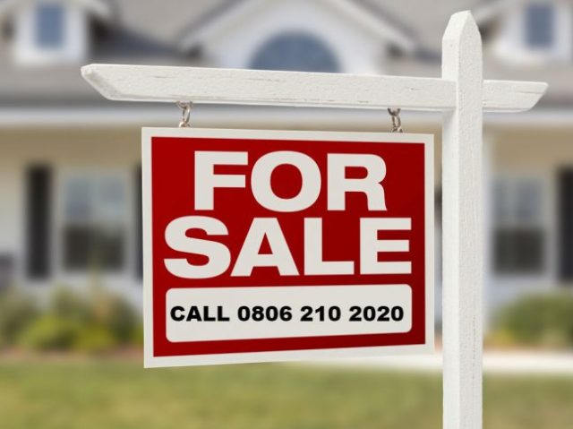 A properties for sale sign.