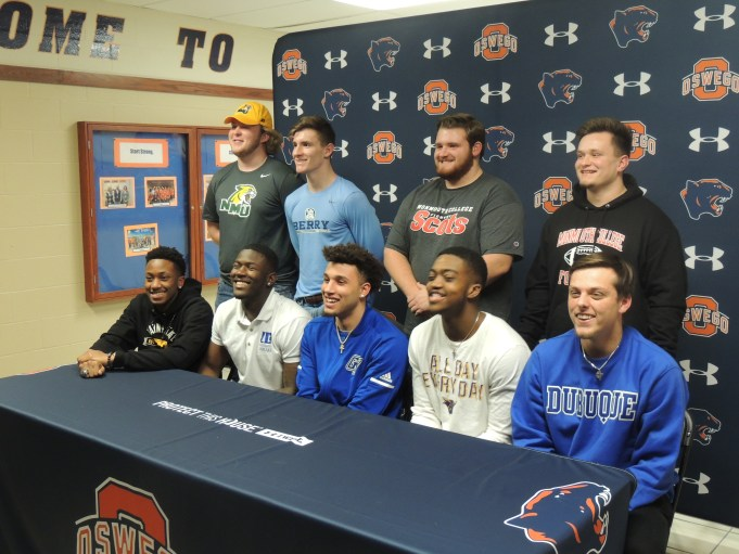 OHS football players at signing day.