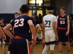 OHS basketball players (23 and 53) and OE basketball player (23)