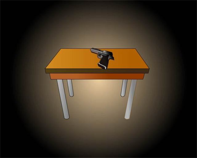 Graphic of a gun lying on a desk