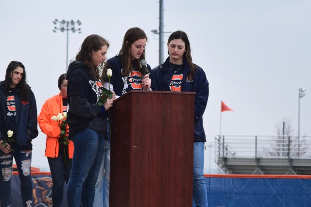 Panther softball players speaking at the podium