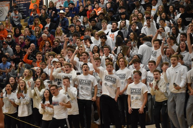 Oswego's student section dressed in all white jumping up and down as the Panthers tied it up to force double overtime.