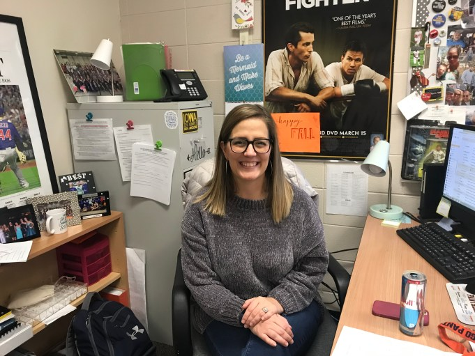 Teacher Sarah Carlson sitting at her desk in her second floor classroom.