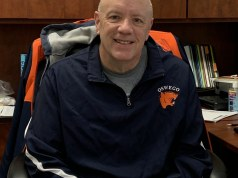 Darren Howard in his office wearing an Oswego High School zip-up.