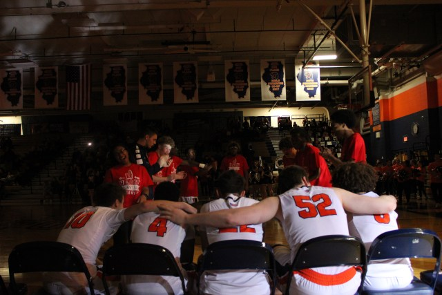 The Oswego starting lineup waits for their names to be called prior to the start of the game.