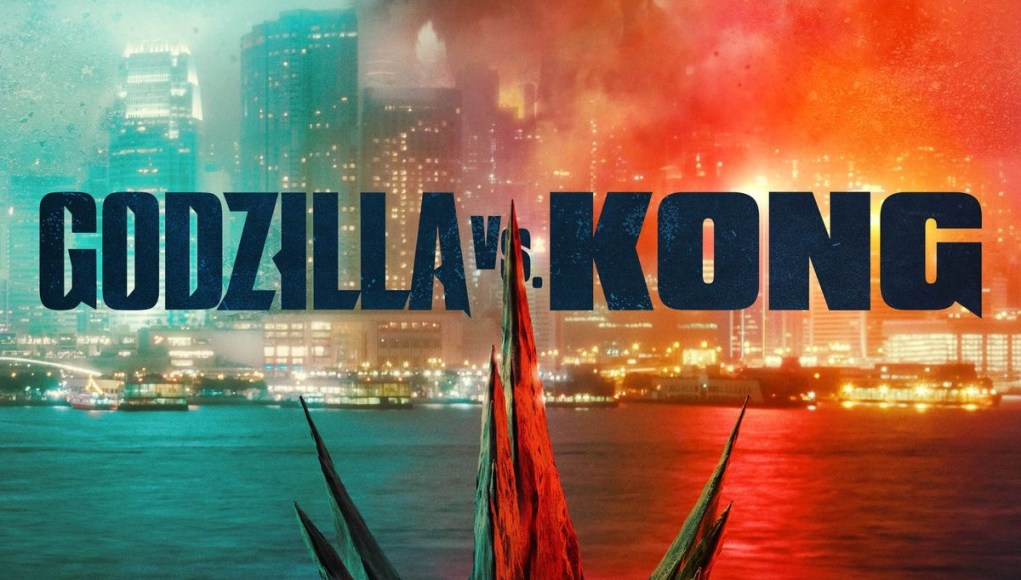 Godzilla vs. Kong Movie poster depicting Godzilla emerging from the sea as he approaches King Kong.