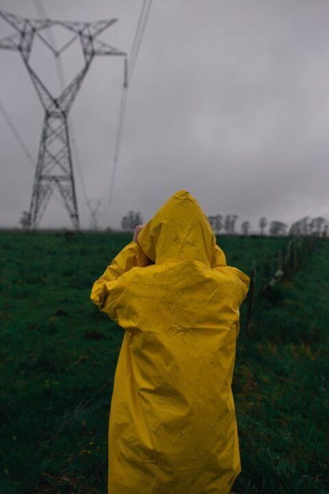 person wearing yellow raincoat