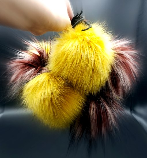 faux fur pom poms made my threadhead knits