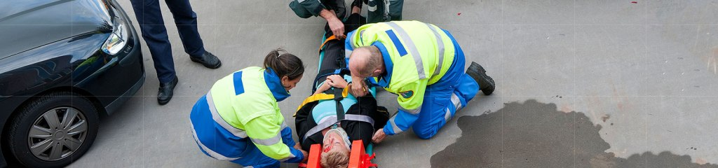Car Accidents - paramedics are helping a woman in a car accident