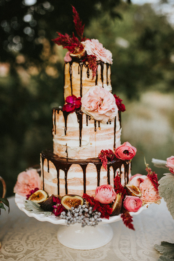 flower topped naked fall wedding cake with chocolate drizzle   Oh     flower topped naked fall wedding cake with chocolate drizzle