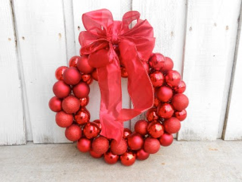 $6 Dollar Tree Wire Hanger Christmas Ornament Wreath by Six Sisters Stuff - 30 Incredible Dollar Store DIY Christmas Decor Ideas. Easy to make decorations that you can do on a small budget. Make beautiful and easy centrepieces, ornaments, candle holders and mason jar crafts. These awesome Dollar Tree DIY Christmas crafts are simple enough to be made with your kids. Just click on this to find out more or pin for later!