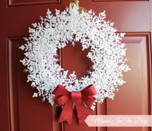 Dollar Store DIY Snowflake Wreath by Mama In The Deep - 30 Incredible Dollar Store DIY Christmas Decor Ideas. Easy to make decorations that you can do on a small budget. Make beautiful and easy centrepieces, ornaments, candle holders and mason jar crafts. These awesome Dollar Tree DIY Christmas crafts are simple enough to be made with your kids. Just click on this to find out more or pin for later!