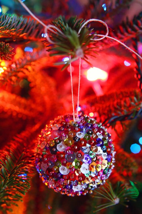 DIY Sequin Sparkles Ornament - 30 Incredible Dollar Store DIY Christmas Decor Ideas. Easy to make decorations that you can do on a small budget. Make beautiful and easy centrepieces, ornaments, candle holders and mason jar crafts. These awesome Dollar Tree DIY Christmas crafts are simple enough to be made with your kids. Just click on this to find out more or pin for later!