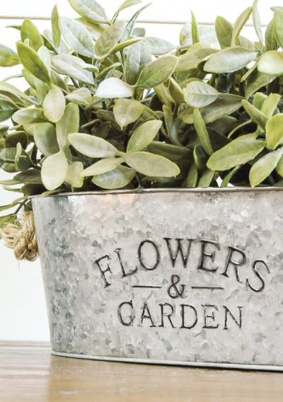 How To Easily Age Inexpensive Galvanized Planters - DIY Farmhouse decor ideas that are so easy to do you have no excuse not to try them! These cheap DIY rustic decor projects will change the look of your bedroom, mantle, living room, and bathroom on a small budget! #Farmhouse #FarmhouseDIYS #DIYFarmhouseProjects #DIYFarmhouseCrafts