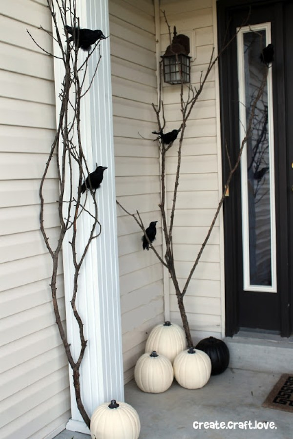 Raven Inspired Halloween Porch- The Best DIY Halloween decorations for outdoor and yard to turn your porch into a haunted house. How to make graveyards, spider webs, chicken wire ghosts and other awesome and scary. These are so easy to make even kids can do them. #halloween #halloweendecorations