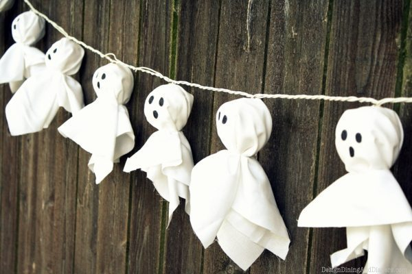 Illuminated Ghost Garland- The Best DIY Halloween decorations for outdoor and yard to turn your porch into a haunted house. How to make graveyards, spider webs, chicken wire ghosts and other awesome and scary. These are so easy to make even kids can do them. #halloween #halloweendecorations