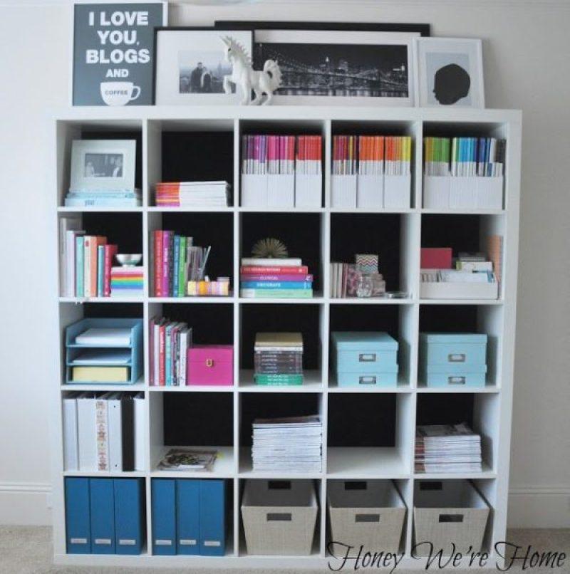 Fabric Lined Ikea Kallax Book Case - 21 genius DIY IKEA Kallax hacks to organize your bedroom, playroom, kitchen, entryway, closet, and office. #ikeahack #ikeakallax #kallax #ikeafarmhouse #ikeaideas #ikea