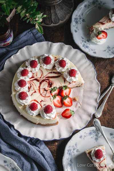 Keto Cheesecake With Raspberry Swirl - Easy Keto Cheesecake recipes that taste like real cheesecake! These no-bake keto cheesecakes are absolutely DELICIOUS! Click to find your new favorite quick keto dessert! #ketorecipes #ketodiet #ketocheesecake #ketodessert
