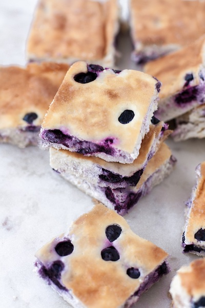 Low Carb Blueberry Cheesecake Bars - Easy Keto Cheesecake recipes that taste like real cheesecake! These no-bake keto cheesecakes are absolutely DELICIOUS! Click to find your new favorite quick keto dessert! #ketorecipes #ketodiet #ketocheesecake #ketodessert