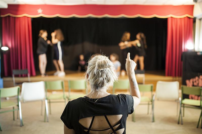 theatre teacher praising a class