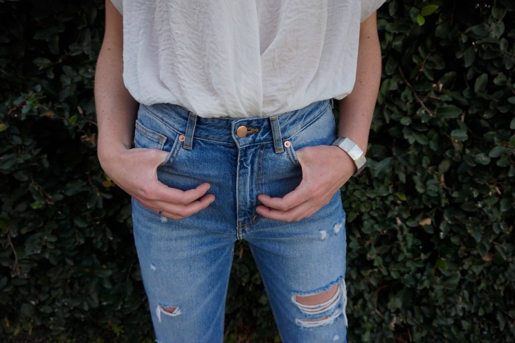 Valentine's date style cute and chice distressed cropped denim and white silk blouse.