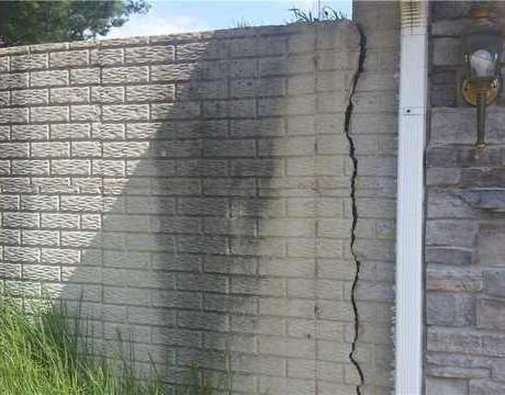 Helical Pier and Wall Anchors Stabilize a Failing Retaining Wall in Fredericktown, OH