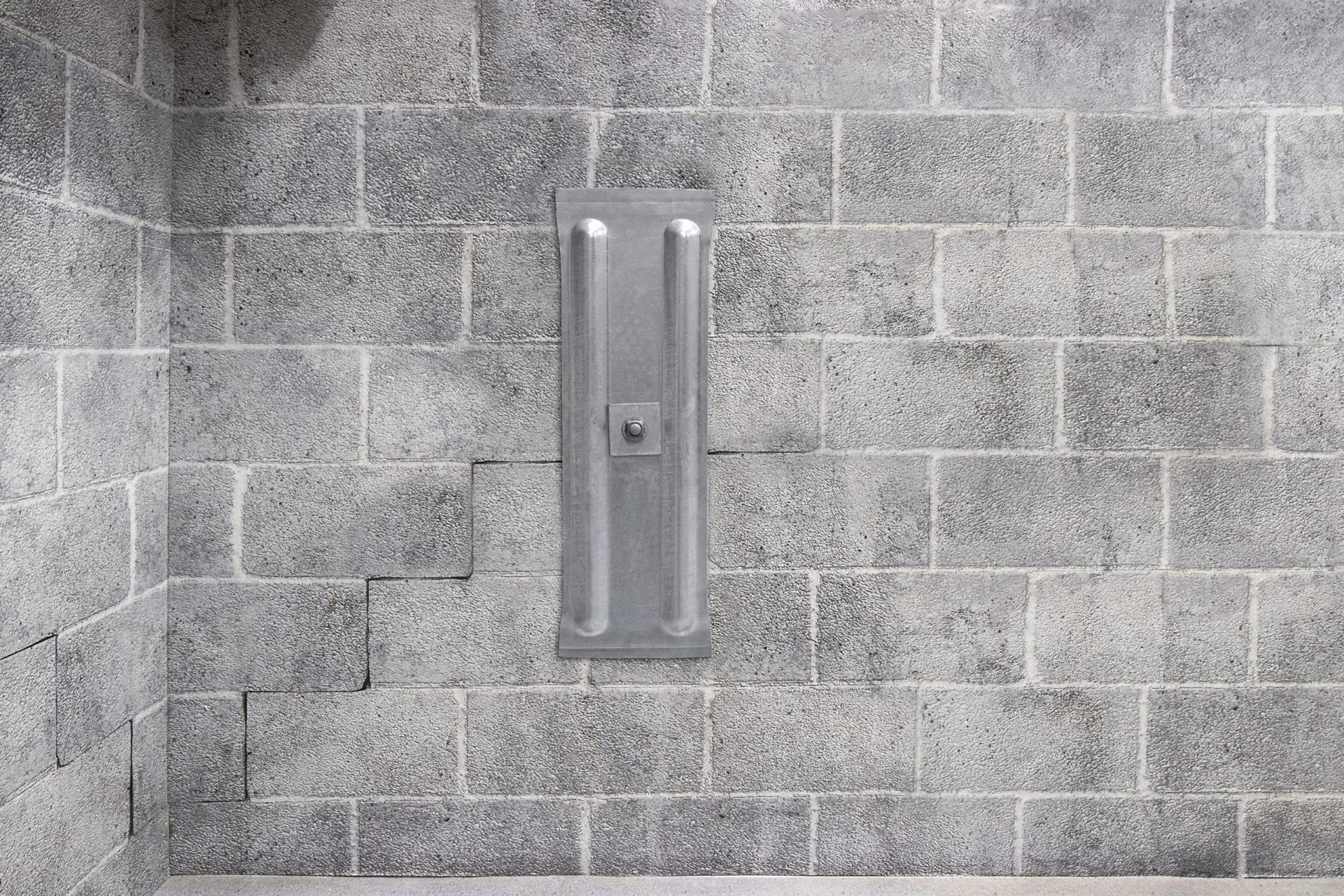 Installed basement wall anchor