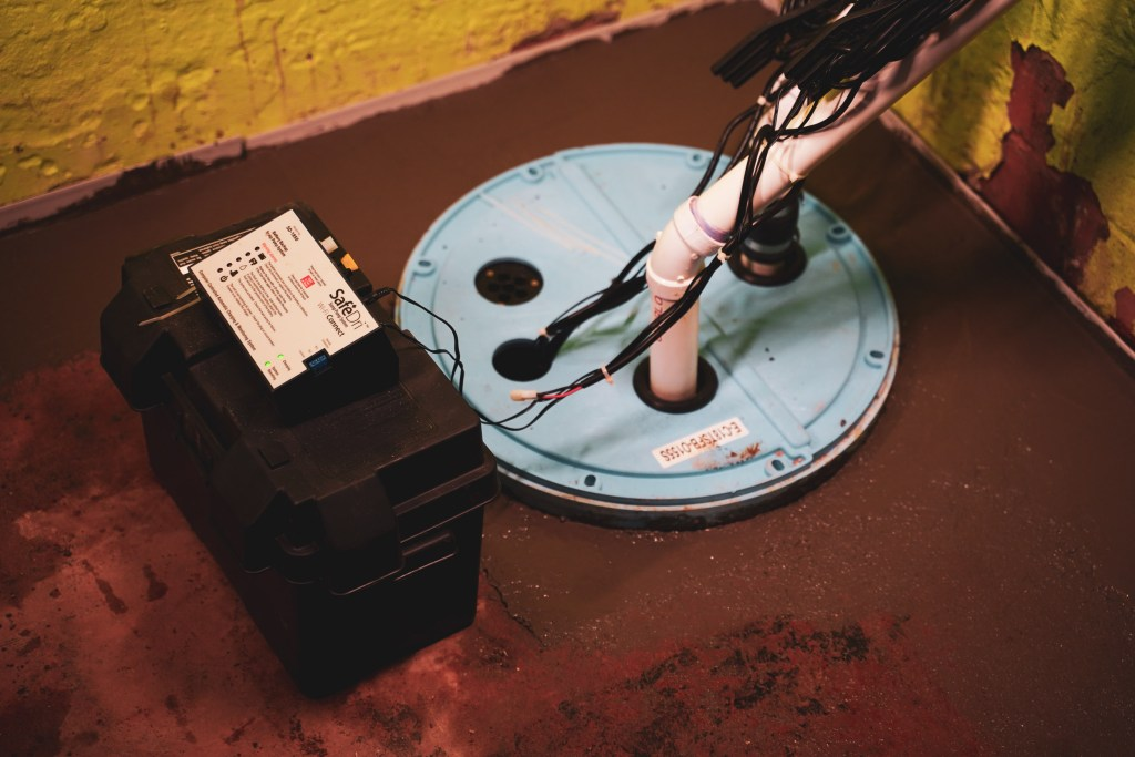installed sump pump with back up battery