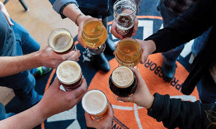 """Crooked Handle Brewing - """"cheers"""" with 7 glasses."""