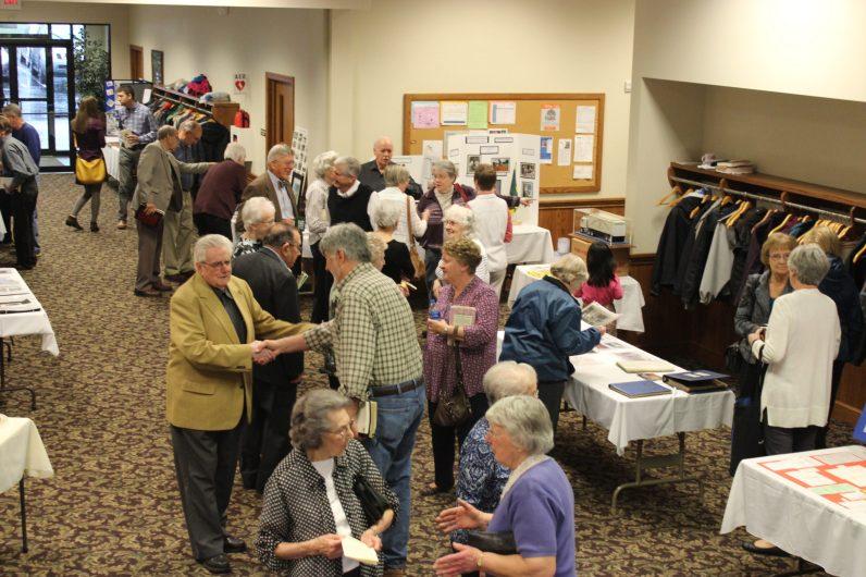Oak Grove guest and members meet amidst multiple displays.